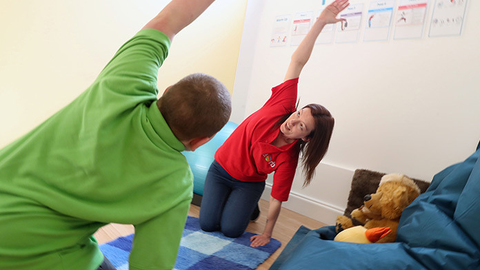Orbis Group - Ty Seren children learning yoga