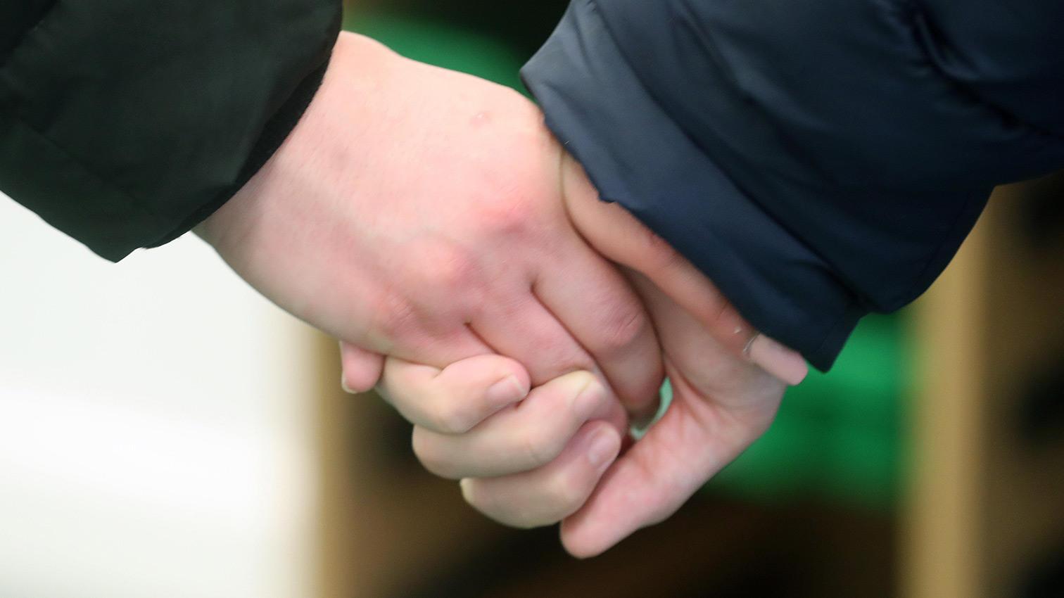 Orbis Group - Ty Coryton school holding hands