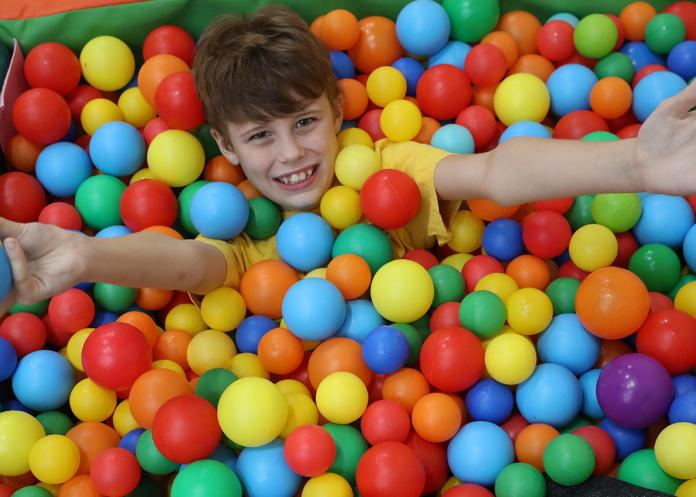 Orbis Group - Summergil house child playing in ball pit
